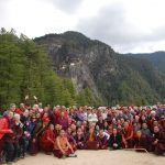 HE Jetsun Khandro Rinpoche, Minling Sangyum Kushok, Jetsun Kushok, Dungse Jigdral, Jetsun Gautami, Kunda Britton, monks and nuns of Mindrolling and sangha members gather at the base of Taktsang in Bhutan.