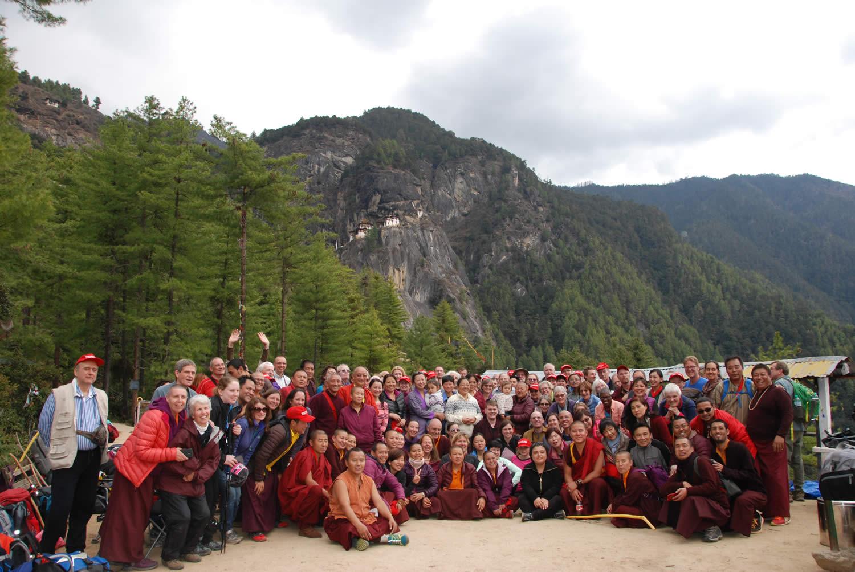 HE Jetsun Khandro Rinpoche, Minling Sangyum Kushok, Jetsun Kushok, Dungse Jigdral, Jetsun Gautami, Kunda Britton, monks and nuns of Mindrolling and sangha members gather at the base of Taktsang in Bhutan.