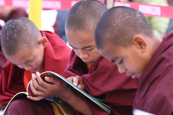 Young monks enjoy the Ngagyur Nyingma College Silver Jubilee book